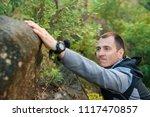 young man climbing mountain rock | Shutterstock . vector #1117470857