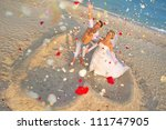 beach wedding of happy newlywed ... | Shutterstock . vector #111747905