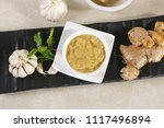 ginger garlic paste with mortar ... | Shutterstock . vector #1117496894