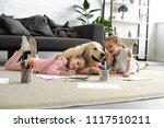 Smiling Kids Lying On Floor...