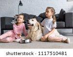 cute kids with golden retriever ... | Shutterstock . vector #1117510481