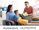 young parents helping their... | Shutterstock . vector #1117527974