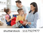 young parents helping their... | Shutterstock . vector #1117527977