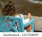 barefoot woman in white... | Shutterstock . vector #1117528457