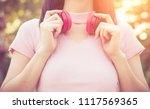 close up pretty girl listening... | Shutterstock . vector #1117569365