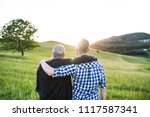 an adult hipster son with... | Shutterstock . vector #1117587341