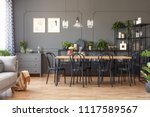 lamps above wooden dining table ... | Shutterstock . vector #1117589567