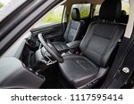 Leather black seats in the car interior on the front row for the passenger and driver. - stock photo