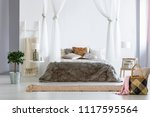 fur coverlet placed on king... | Shutterstock . vector #1117595564