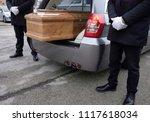 coffin inside funeral wagon | Shutterstock . vector #1117618034