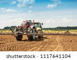 tractor with sprayer on the... | Shutterstock . vector #1117641104
