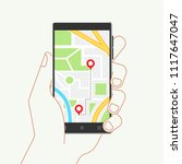 hand holding phone with map and ... | Shutterstock .eps vector #1117647047