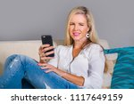 beautiful and happy blond woman ... | Shutterstock . vector #1117649159
