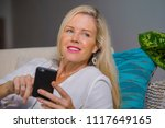 beautiful and happy blond woman ... | Shutterstock . vector #1117649165