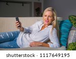beautiful and happy blond woman ... | Shutterstock . vector #1117649195