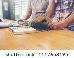 businessteam discussing ideas... | Shutterstock . vector #1117658195
