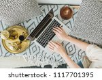 young woman typing on laptop in ...   Shutterstock . vector #1117701395