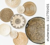 decorative straw plates on... | Shutterstock . vector #1117701431