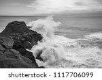 waves breaking on rocks  iceland | Shutterstock . vector #1117706099
