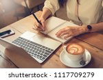 the woman is writing her work...   Shutterstock . vector #1117709279