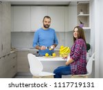 young pregnant couple cooking... | Shutterstock . vector #1117719131