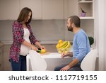 young pregnant couple cooking... | Shutterstock . vector #1117719155