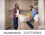 young pregnant couple cooking... | Shutterstock . vector #1117719161