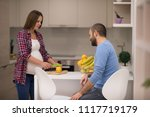 young pregnant couple cooking... | Shutterstock . vector #1117719179
