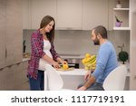 young pregnant couple cooking... | Shutterstock . vector #1117719191
