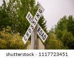 rail road crossing xing x sign...   Shutterstock . vector #1117723451