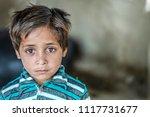 closeup of a poor staring... | Shutterstock . vector #1117731677