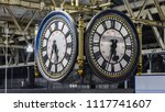 Large 4 Faced Clock Hanging In...