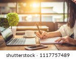 close up of woman hand writing...   Shutterstock . vector #1117757489