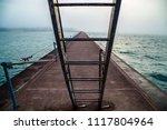 lighthouse breakwater quay two...   Shutterstock . vector #1117804964