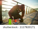 man tying his shoes | Shutterstock . vector #1117820171