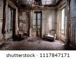 Chairs In An Abandoned Room In...