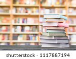 opened book on a pile of old... | Shutterstock . vector #1117887194