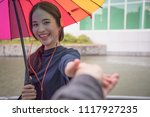 traveler couple holding hands... | Shutterstock . vector #1117927235