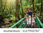 family hiking in jungle. father ... | Shutterstock . vector #1117932767