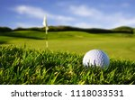 Small photo of Golf ball on tee ready to be shot on the green golf course.Golf is a club and ball sport in which players use various clubs to hit balls into a series of holes on a course in few strokes as possible.