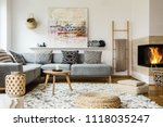 wooden table next to grey... | Shutterstock . vector #1118035247