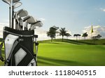 Small photo of Golf drivers, putters on a golf bag on the green golf course.Golf is a club and ball sport which players use various clubs to hit balls into a series of holes on a course in few strokes as possible.