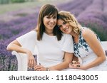 young sisters sitting close | Shutterstock . vector #1118043005