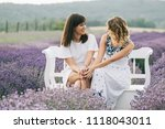 young sisters sitting close | Shutterstock . vector #1118043011