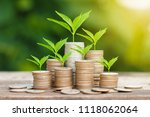 tree growing on coins stack... | Shutterstock . vector #1118062064