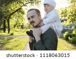 father with daughter baby on... | Shutterstock . vector #1118063015