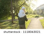 father with daughter baby on... | Shutterstock . vector #1118063021