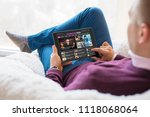 man reading tech news on tablet ... | Shutterstock . vector #1118068064