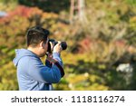 man with a camera on the... | Shutterstock . vector #1118116274