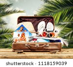 summer brown suitcase and photo ... | Shutterstock . vector #1118159039